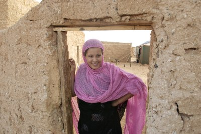 A Sahrawi woman stands in the doorway at a refugee Camp.