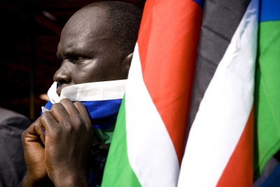 A man reacts as the preliminary results of the referendum are announced in Juba on January 30, 2011 © Siegfried Modola/IRIN