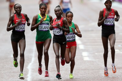 Olympic marathon runners, from left, Edna Ngeringwony Kiplagat, 20th, Tiki Gelana, gold, Mary Jepkosgei Keitany, 4th place, Mare Dibaba, 23rd, and Priscah Jeptoo, silver.