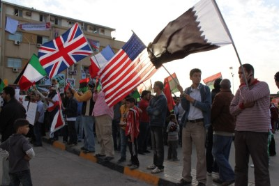 Benghazi residents hold Italian, British, French, American, Qatari and Libyan rebel flags outside the city's main courthouse during a demonstration. Foreign intervention against Gaddafi's forces has earned the Western nations and tiny-but-powerful Qatari significant goodwill from the community.