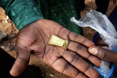 A man holds a piece of gold mined and processed in Zamfara State.