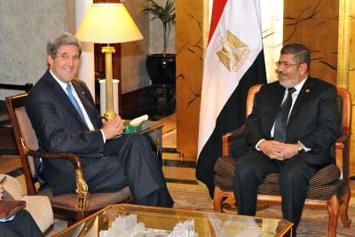 U.S. Secretary of State John Kerry meets ousted President Mohamed Morsi (file photo).