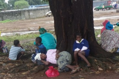 Suspected Ebola patients waiting inside ELWA fence for medical attention in Monrovia, Liberia.