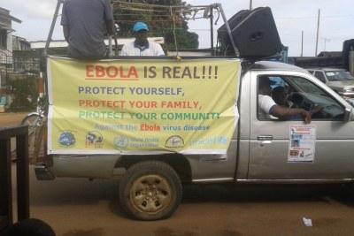An Ebola sensitisation team patrols with loud speakers
