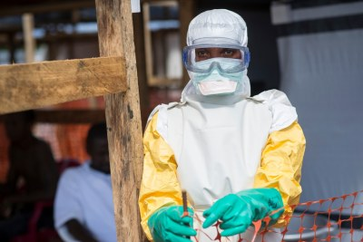 A Médecins Sans Frontières (MSF) nurse enters the high-risk area of Kailahun after getting dressed in protective clothing (file photo).