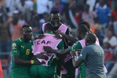 Le Sénégal célèbre lors de son match de Coupe d'Afrique des Nations 2015 contre le Ghana, qu'il a remporté.