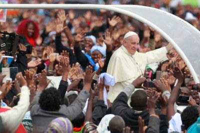 Pope Francis arrives at the University of Nairobi grounds for the papal mass.
