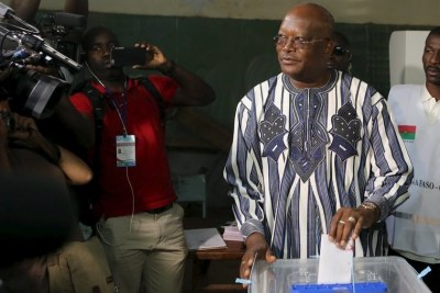 Roch Marc Christian Kabore votes during the presidential and legislative election at a polling station in Ouagadougou on November 29.