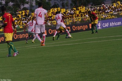 Tunisia's Mohamed Ben Amor tries to steal the ball from a Guinean defender.