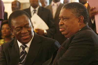 Phelekezela Mphoko (right) was, along with current President Emmerson Mnangagwa (left), one of two vice presidents at the time of the ouster of Robert Mugave Mugabe in November 2017.