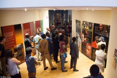 Visitors read messages on the Genocide at Kigali Genocide Memorial Centre (file photo).