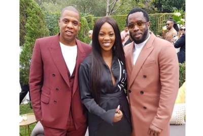 Tiwa Savage with Jay Z and P.Diddy.