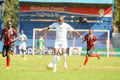 Harambee Stars midfielder Daniel Mwaura (centre) dribbles the ball during their international friendly match against Malawi at Kenyatta Stadium in Machakos on April 18, 2017.