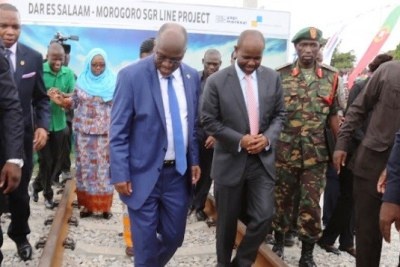 President John Magufuli inspects a section of the Standard Gauge Railway project after laying the foundation stone at Pugu Station on the outskirts of Dar es Salaam.