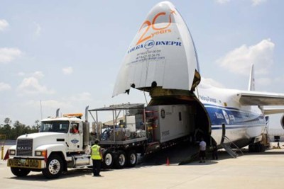 GE's TM2500 mobile aeroderivative gas turbine generator set being loaded onto a transportation airplane
