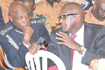 Former security minister Henry Tumukunde, right, with the former inspector general of police Kale Kayihura (file photo).