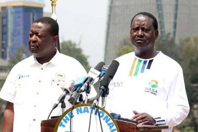 National Super Alliance co-principals Raila Odinga and Musalia Mudavadi address the media at Capitol Hill Square in Nairobi.