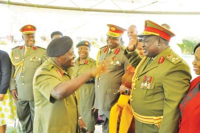 General Katumba Wamala salutes fellow UPDF officers.