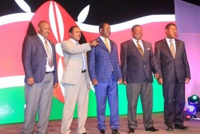 From left: Nasa co-principals Isaac Ruto, Kalonzo Musyoka, Raila Odinga, Musalia Mudavadi and Moses Wetang'ula at the launch of the coalition's manifesto at Ngong Racecourse in Nairobi.