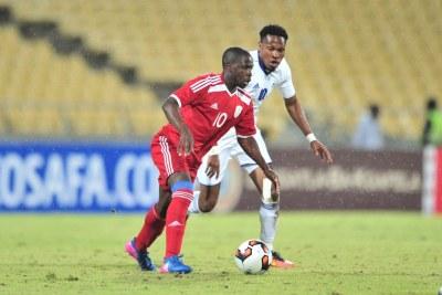 Deon Hottoi of Namibia challenged by Tsoanelo Koetle of Lesotho.
