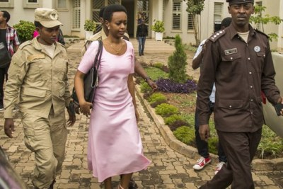 Diane Shima Rwigara escorted out of the Kigali High Court on November 7, 2017.