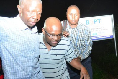 Red Pepper's Chief Commercial Officer James Mujuni, centre, being dragged by security operatives on Tuesday November 21, 2017.