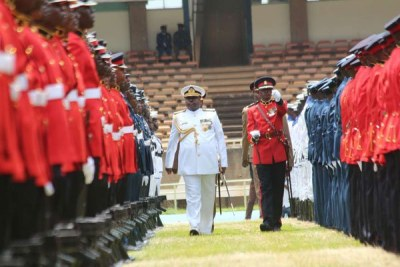 Chief of Defence Forces Samson Mwathethe inspects a guard of honour as the military prepares for the swearing-in of Uhuru Kenyatta at Kasarani on November 22, 2017.