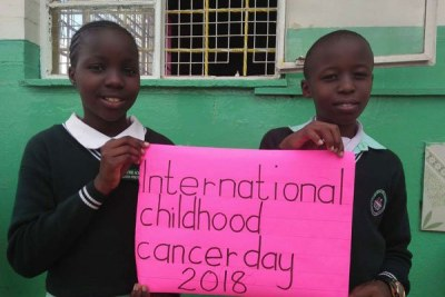 Pupils promote awareness on cancer during the International Childhood Cancer Day on February 15, 2018.