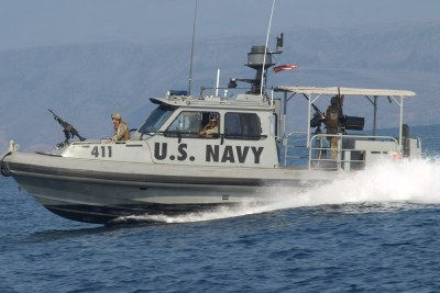 A U.S. Navy vessel operating from the biggest American military base in Africa patrols the port of Djibouti.