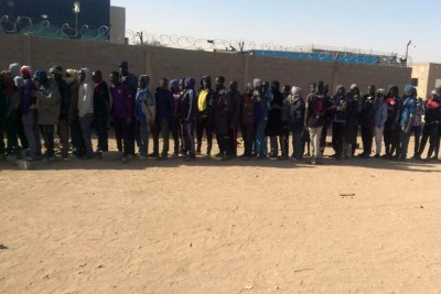 Sudanese refugees waiting to be loaded into trucks to be deported to Libya.
