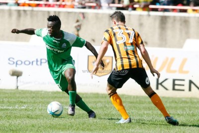 Gor Mahia forward Ephraim Guikan attempts to go past Hull City's Robbie Mackenzie during an international friendly match at the Moi Sports Centre Kasarani in Nairobi on May 13, 2018.