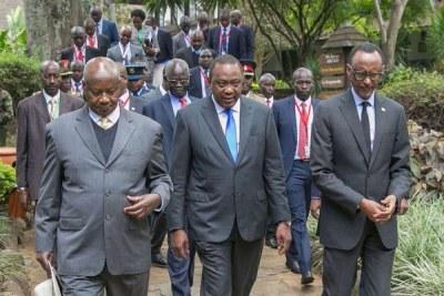 From left: Presidents Yoweri Museveni (Uganda), Uhuru Kenyatta (Kenya) and Paul Kagame (Rwanda) arrive for the 14th Summit on the Northern Corridor Integration Project at Safari Park Hotel in Nairobi on June 26, 2018.