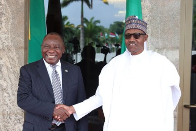 President Muhammadu Buhari welcoming visiting President Cyril Ramaphosa of South Africa at the Presidential Villa.