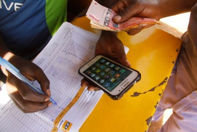 ICT and National Guidance Minister Frank Tumwebaze says that the decision meant that Uganda's drive towards achieving a cashless economy remained on track.