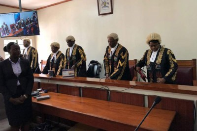 The judges take their seats before reading of the verdict at Mbale High Court on July 26, 2018 (file photo).