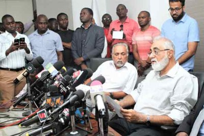 Gullam Dewji. left, father of missing Mo Dewji, is flanked by relative Azim Dewji during a press briefing in Dar es Salaam.
