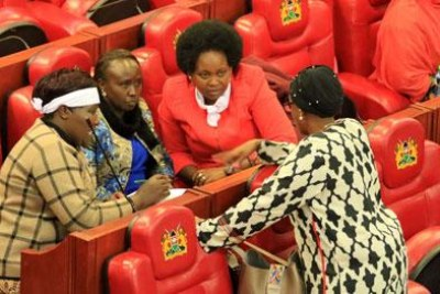 Some MPs hold a discussion during the debate on the Constitution of Kenya (Amendment) Bill 2018 in the House on November 21, 2018.
