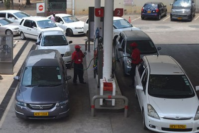 Motorists queue for fuel at a filling station in Harare.