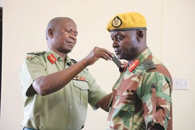 Zimbabwe Defence Forces commander General Phillip Valerio Sibanda confers a new rank to Major General Anselem Nhamo Sanyatwe who was promoted from the rank of Brigadier General.