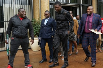 Walter Magaya (in black) leaves court on Tuesday February 6, 2019.