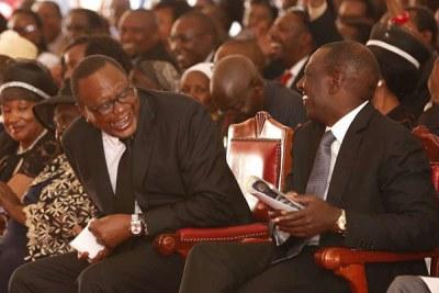 President Uhuru Kenyatta (left) and his deputy William Ruto attend musician Joseph Kamaru's burial in Murang'a (file photo).