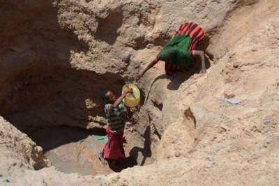 Women fetch water from a well (file photo).