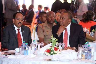 Presidents Mohamed Abdullahi Mohamed Farmaajo of Somalia and Uhuru Kenyatta of Kenya at a national prayer breakfast held at Safari Park Hotel in Nairobi (file photo).