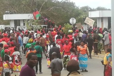 MCP supporters march to Capital Hill in protest against poll results