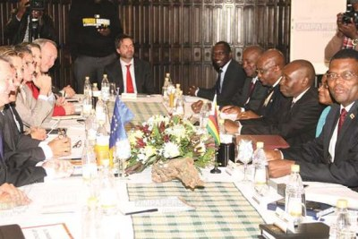 Secretary for Foreign Affairs and International Trade Ambassador James Manzou, right,  chairs the launch of political dialogue between Zimbabwe and the European Union in Harare.