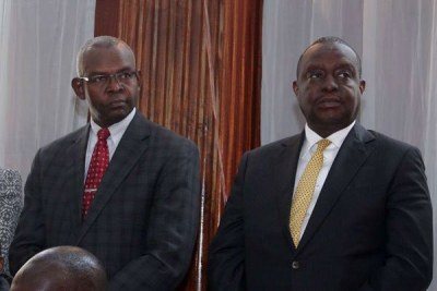 Treasury Cabinet Secretary Henry Rotich (right) and his Principal Secretary Kamau Thugge at a Milimani court in Nairobi on July 23, 2019.