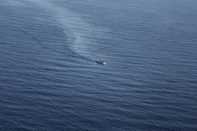 A boat packed with people is spotted in the Mediterranean Sea from an Italian rescue helicopter in June 2014.
