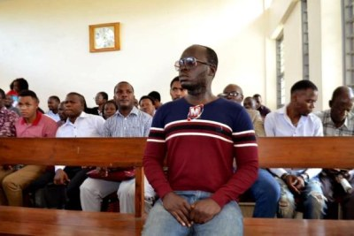 Erick Kabendera in court where he was charged with leading organized crime, failure to pay tax and money laundering.