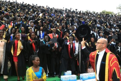 Prof Philip Cotton, University of Rwanda's Vice-Chancellor, greets students at the graduation ceremony held in Huye in 2018.