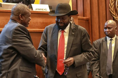 President Salva Kiir, right, of South Sudan shakes hands with Riek Machar after concluding a peace deal to end the conflict in the country in September 2018.